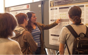 Student presenting a research poster.