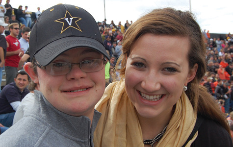 Next Steps at Vanderbilt student with Down syndrome at a football game with a Vanderbilt Ambassadore