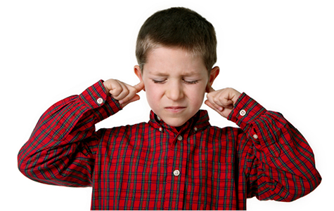 Young boy covering his ears