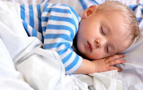 Stock photo of young boy sleeping