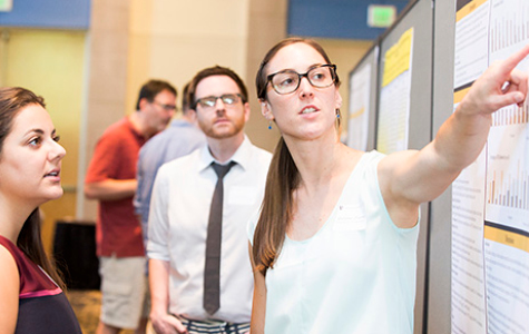 Graduate students/postdocs presenting their posters to attendees at VKC Science Day 2016. Photo by Susan Urmy / Vanderbilt University.