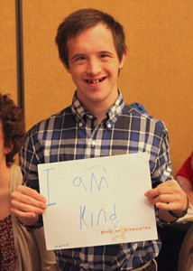 Hire my strengths participant holding his I am Kind sign