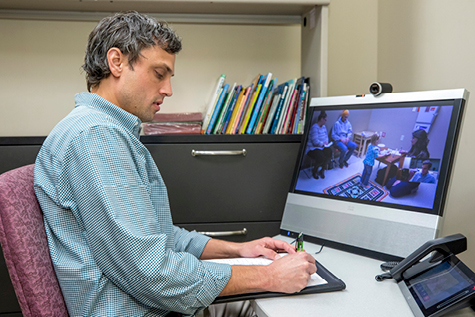 Jeffrey Hine, Ph.D., BCBA-D, videoconferencing with a patient