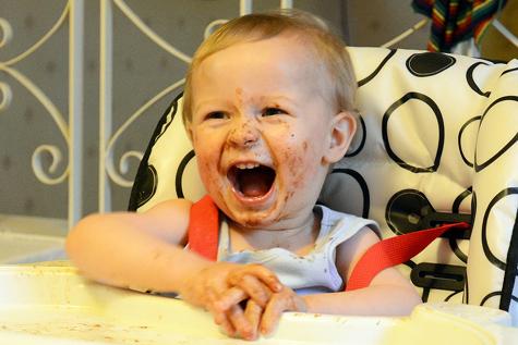 Happy toddler eating