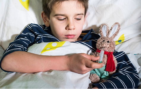 Stock photo of young boy in hospital bed
