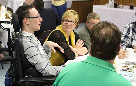 Photo of adults talking at Community Conversation