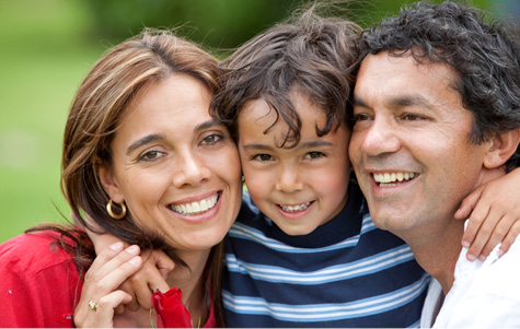 Stock photo of parents with young son.