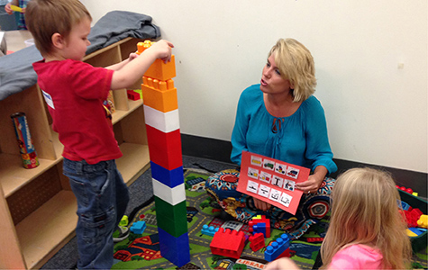 Evidence-based practices in this model early childhood inclusive classroom include the use of visual supports in the structured play center. Photo courtesy TRIAD.