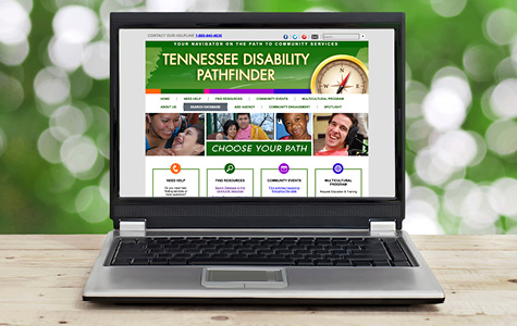 Laptop with screen showing Tennessee Disability Pathfinder's website