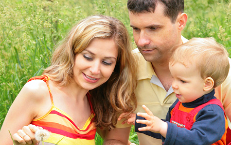 Stock photo of parents with toddler outside