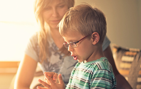 stock photo of young boy counting with his mother