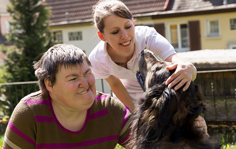 Stock photo of woman with a disability and her friend