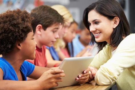 Elementary aged children with teacher