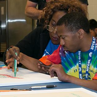 Boy creating art in a workshop