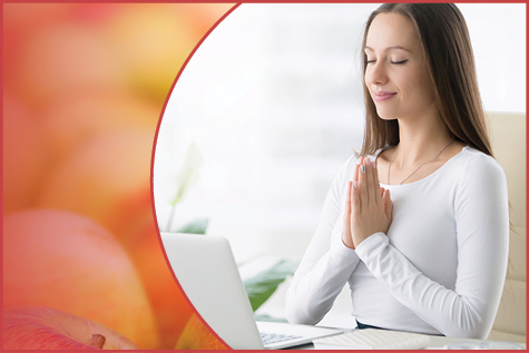Woman practicing deep breathing exercises at her desk