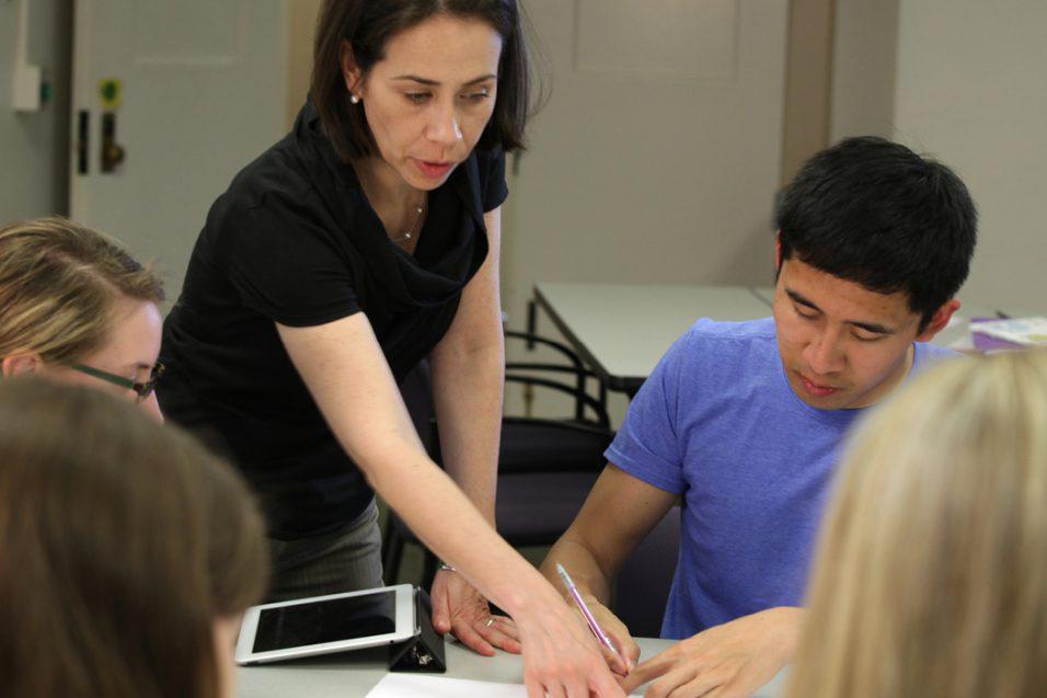 Woman teaching graduate students