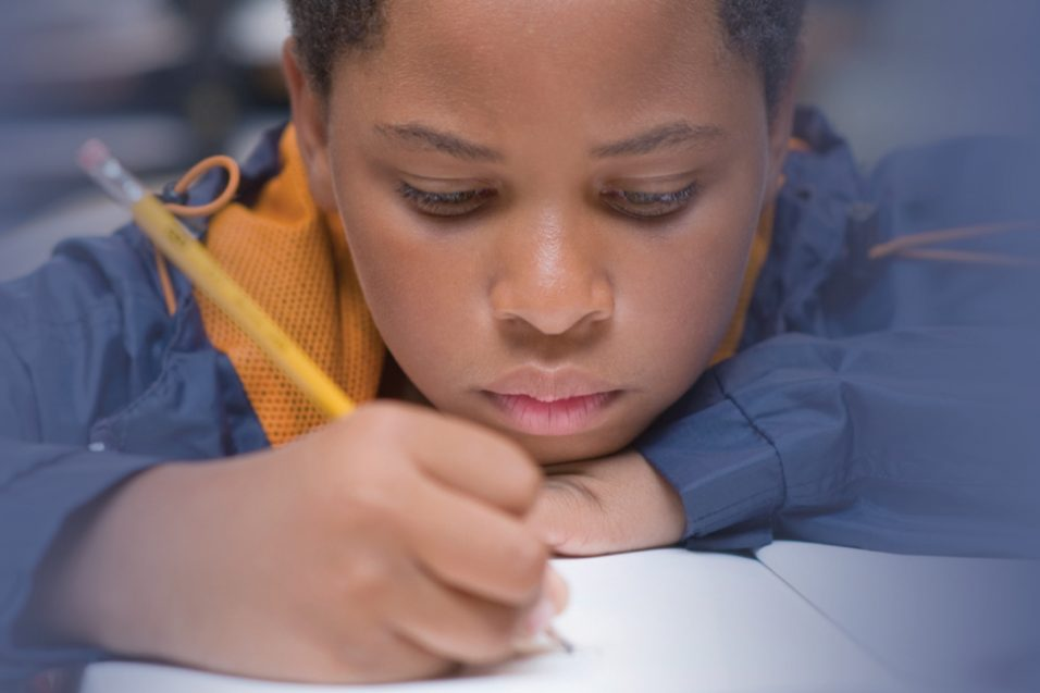 troubled boy doing homework