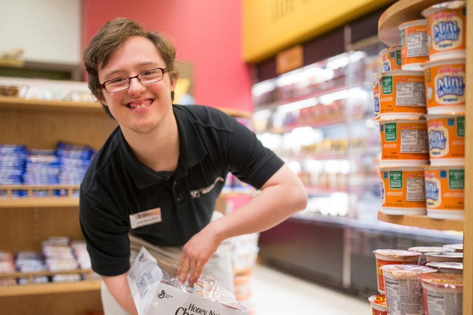 young man working at store