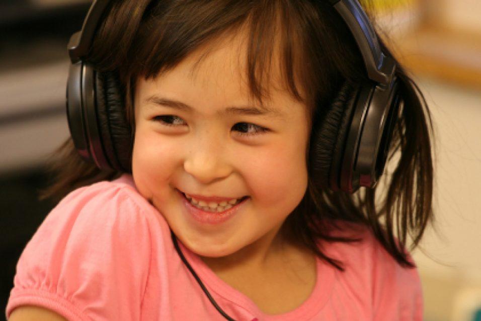 Cheerful girl with headphones