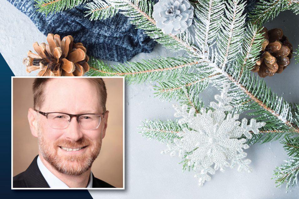 Dr. Neul headshot over winter background